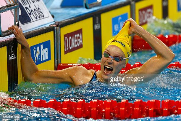 Sarah Sjostrom of Sweden celebrates winning the Women's 50m Butterfly Final on day three of the 12th FINA World Swimming Championships at the Hamad...