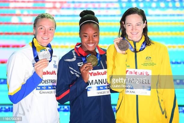 Sarah Sjostrom of Sweden, gold medalist Simone Manuel of the United States and bronze medalist Cate Campbell of Australia pose for photographs after...