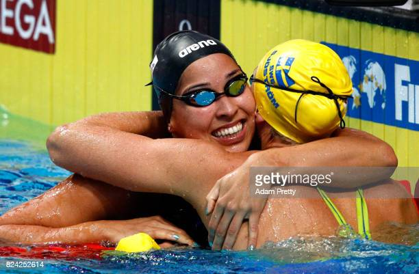 Sarah Sjostrom of Sweden is congratulated by Ranomi Kromowidjojo of the Netherlands after setting a new world record time of 2667 during the Women's...