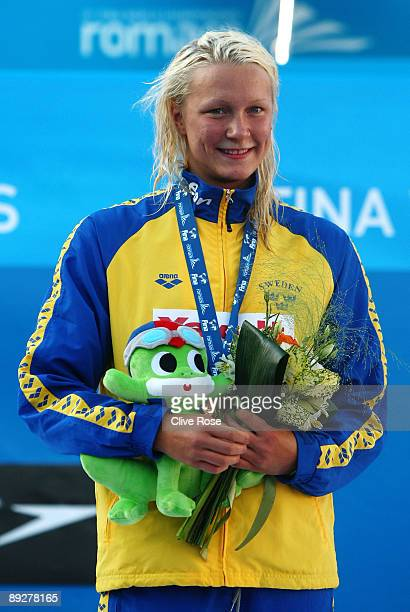 Sarah Sjostrom of Sweden receives the gold medal during the medal ceremony for the Women's 100m Butterfly Final during the 13th FINA World...