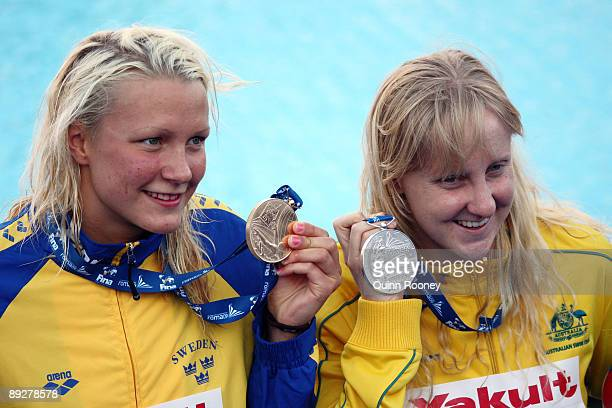 Sarah Sjostrom of Sweden with the gold medal and Jessicah Schipper of Australia with the silver medal during the medal ceremony for the Women's 100m...