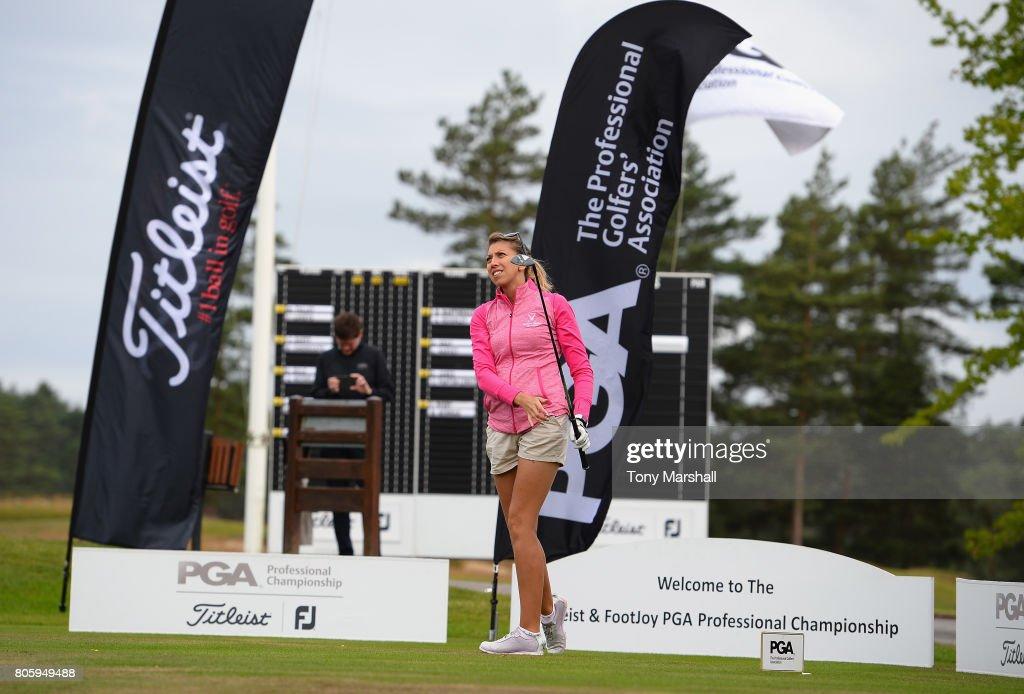 sarah smith of saffron walden golf club plays her first shot on the