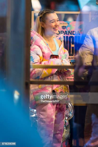 Sarah Snyder is seen wearing pink camouflage Nicola Formichetti jacket and pants in Midtown on November 18 2017 in New York City