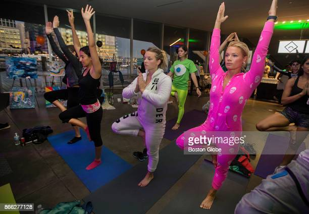 Sarah Somogie right wears her Halloween pajamas during yoga at the early morning Daybreaker yoga/dance party event at the Institute of Contemporary...