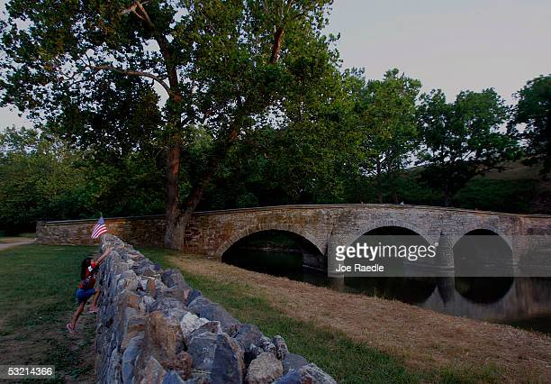 Sarah Spall looks over a stone wall at Burnside Bridge at the Antietam battlefield July 4 2005 where General Robert E Lee ended his first invasion of...