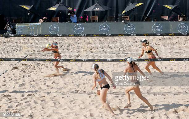 Sarah Sponcil bumps the ball against Angela Bensend and Olaya Pazo as teammate Lauren Fendrick watches during 2018 AVP Austin Open at Krieg Fields on...
