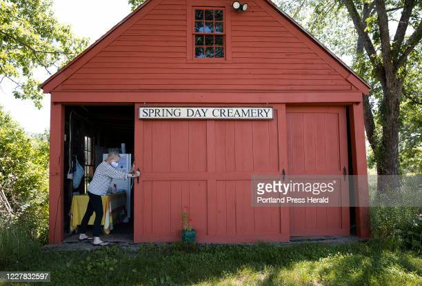 Sarah Spring opens the doors to the barn where customers can purchase cheese from a self-serve station at Spring Day Creamery.