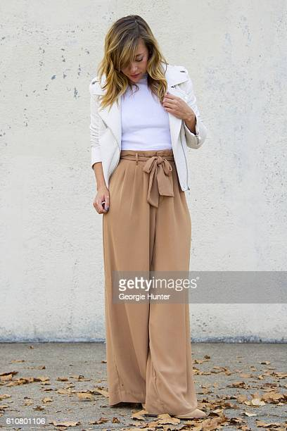 Sarah Stannard wearing sleeveless white HM short ribbed jersey crop top with mock turtleneck ivory Urban Outfitters vegan leather moto jacket with...