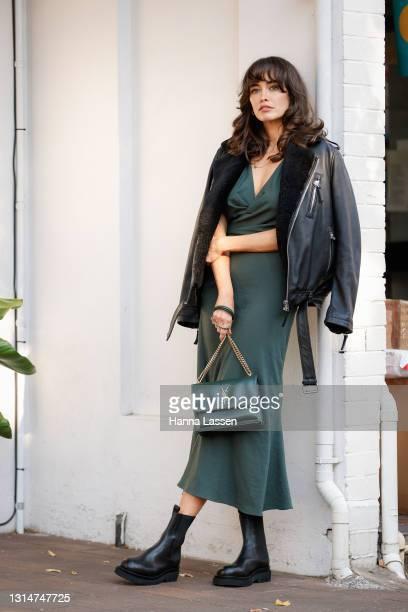 Sarah Stephens is seen wearing dark green One Fell Swoop dress, black Body Skins jacket, dark green YSL bag, Alias Mae shoes and Elizabeth Wiltshire...