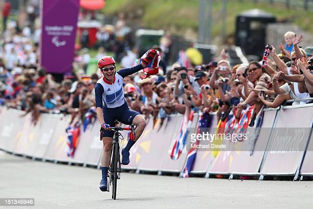 Sarah Storey of Great Britain celebrates winning gold in the Women's Individual C45 Road Race during the road cycling on day 8 of the London 2012...