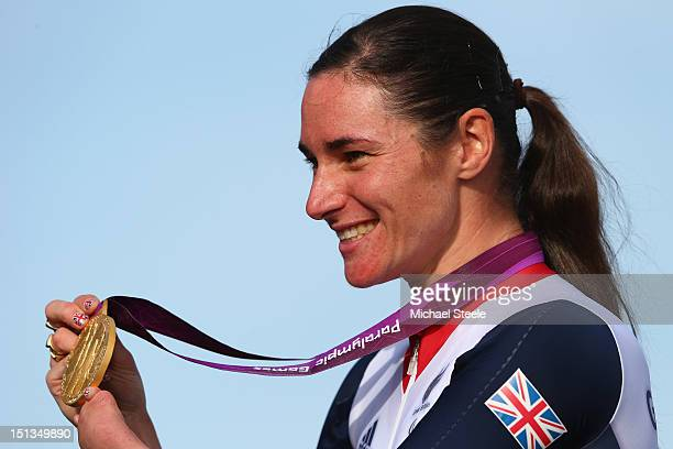 Sarah Storey of Great Britain poses with her eleventh Paralympic gold medal after victory in the Women's Individual C45 Road Race during the road...