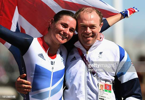 Sarah Storey of Team GB celebrates with husband Barney after winning the Women's Individual C5 Time Trial on day 7 of the London 2012 Paralympic...