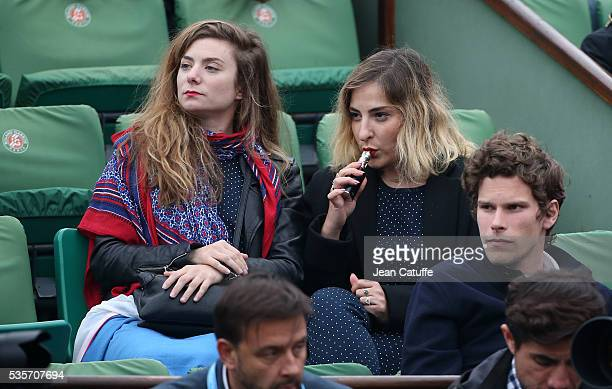 Sarah Suco and Marilou Berry smoking an electronic cigarette attend day 8 of the 2016 French Open held at RolandGarros stadium on May 29 2016 in...