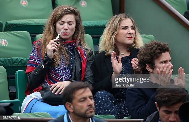 Sarah Suco smoking an electronic cigarette and Marilou Berry attend day 8 of the 2016 French Open held at RolandGarros stadium on May 29 2016 in...