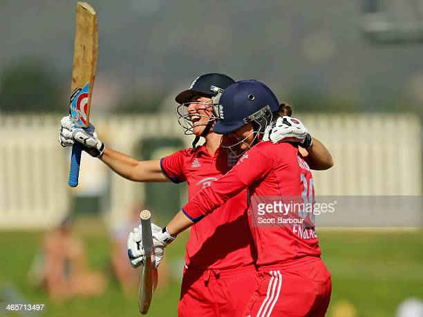Sarah Taylor and Charlotte Edwards of England celebrate after winning the match and retaining the Ashes during game one of the International Twenty20...