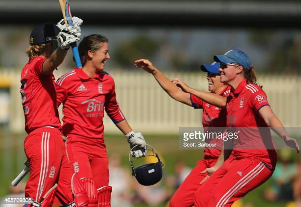 Sarah Taylor and Charlotte Edwards of England celebrate with their teammates after winning the match and retaining the Ashes during game one of the...