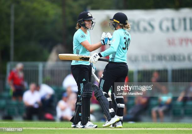 Sarah Taylor and Nat Sciver bump gloves after they hit the winning runs to secure victory in the Kia Super League match between Surrey Stars and...