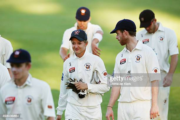Sarah Taylor comes from the field with her male teammates after competing in the men's AGrade match between Northern Districts and Port Adelaide on...