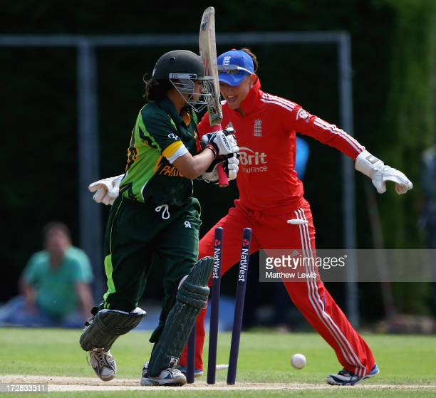 Sarah Taylor of England celebrates after Asmavia Iqbal Khokhar of Pakistan is bowled by Danielle Hazell during the 1st NatWest Women's International...