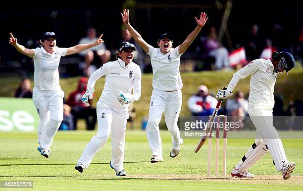 Sarah Taylor of England celebrates after Jenny Gunn dismissed Mithali Raj of India during day one of Women's test match between England and India at...
