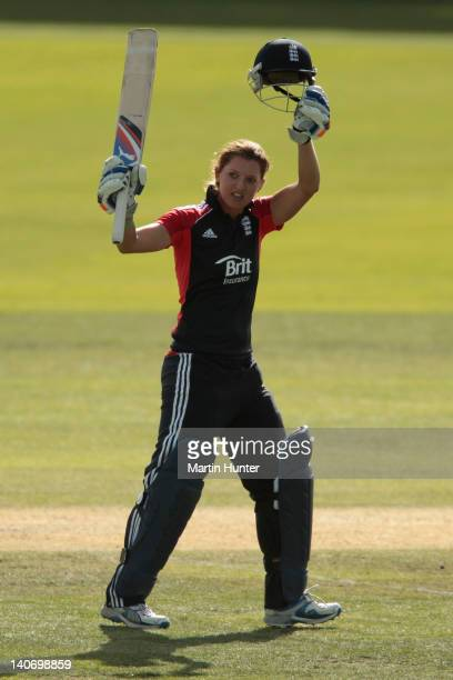 Sarah Taylor of England celebrates after reaching 100 runs during the women's 3rd One Day International match between New Zealand and England at Bert...