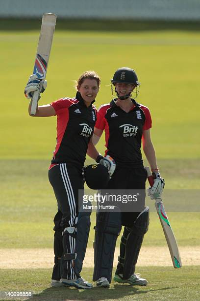 Sarah Taylor of England celebrates with team mate Lydia Greenway after reaching 100 runs during the women's 3rd One Day International match between...