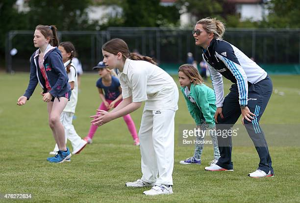Sarah Taylor of England gets involved in a coaching session during England Women's Charity Day at Hampstead Cricket Club on June 7 2015 in Hampstead...
