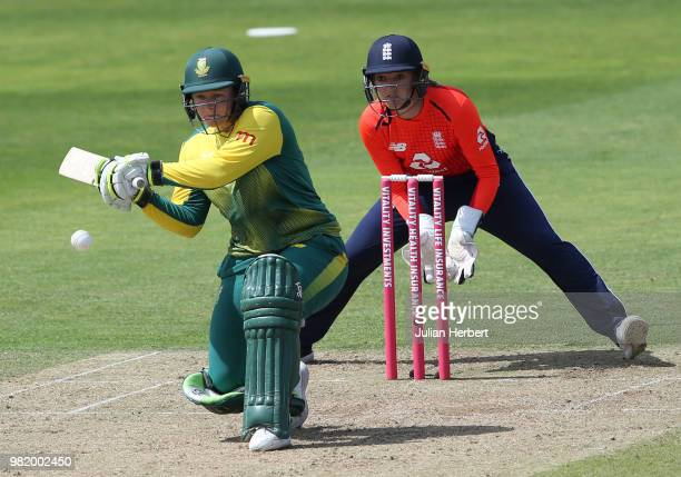 Sarah Taylor of England looks on as Lizelle Lee of South Africa scores runs during the International T23 TriSeries match between England Women and...
