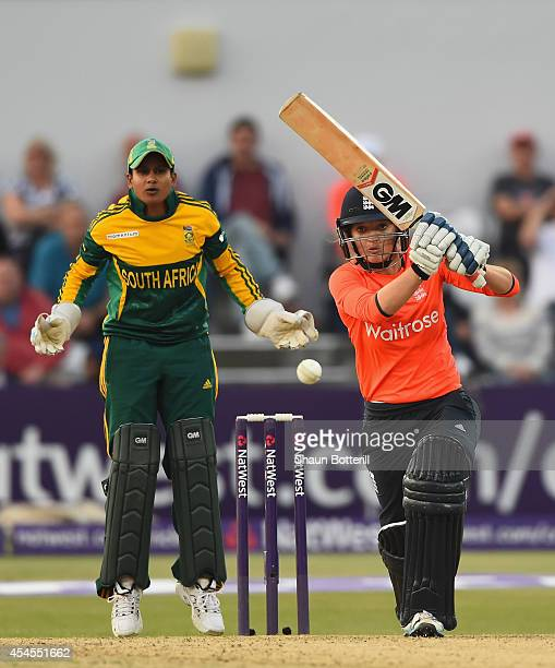 Sarah Taylor of England plays a shot as South Africa wicketkeeper Trisha Ghetty looks on of South Africa during the NatWest Women's International T20...