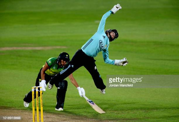 Sarah Taylor of Surrey Stars jumps to reach a ball as Naomi Dattani of Western Storm dives to make her ground during the Women's Kia Super League...
