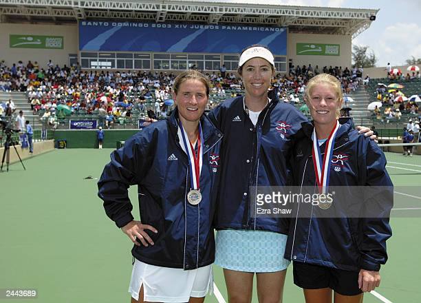 Sarah Taylor of the USA who won the silver medal and Ansley Cargill of the USA who won the bronze medal with their coach Debbie Graham pose for a...