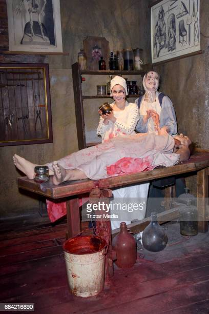 Sarah Tkotsch and protagonist Claudia pose during the VIP Theatre Event At Berlin Dungeon on April 03 2017 in Berlin Germany