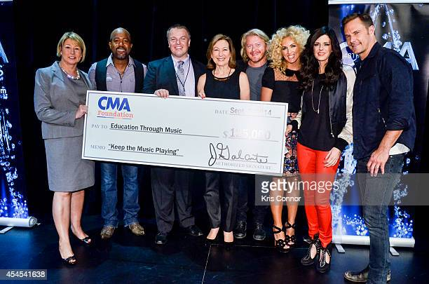 Sarah Trahern Karen Fairchild Darius Rucker Kimberly Schlapman Jimi Westbrook and Phillip Sweet pose with a check during the 48th Annual CMA Awards...