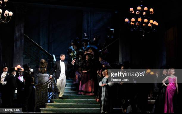 Sarah Tynan as Hanna Glawari and Nathan Gunn as Danilo with artists of the company in English National Opera's production of Franz Lehar's The Merry...