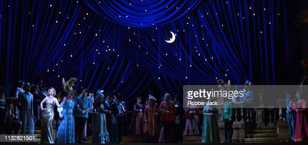 Sarah Tynan as Hanna Glawari with artists of the company in English National Opera's production of Franz Lehar's The Merry Widow directed by Max...