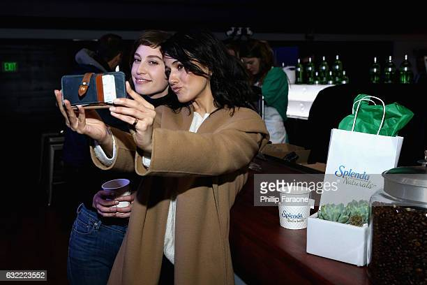Sarah Uslan and Emmanuelle Chriqui warm up at the SPLENDA® Naturals café on January 20th in Park City Utah