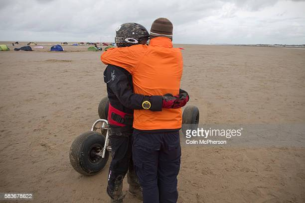 Sarah Vidow of England is consoled by a member of her team after taking part in one of the races at the European Kite Buggy Championships at Hoylake...