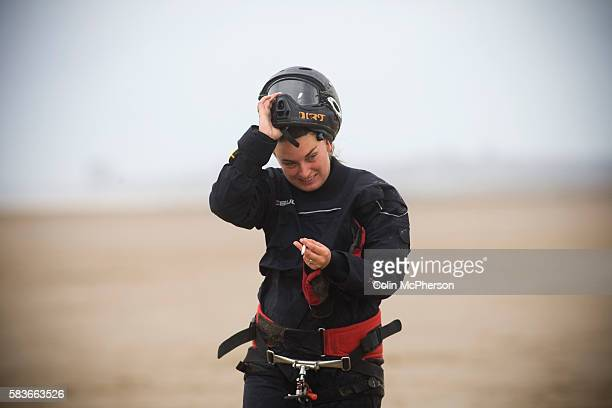 Sarah Vidow of England peeling off her safety helmet after taking part in one of the races at the European Kite Buggy Championships at Hoylake Wirral...