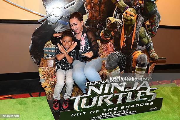 Sarah Vivan and her son Dwayne Michael Carter III attend Teenage Mutant Ninja Turtles Out Of The Shadows Atlanta screening at AMC Phipps Plaza on May...