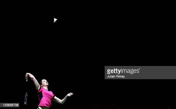 Sarah Walker of England plays a smash in her match against PI Hongyan of France during day one of the BWF World Badminton Championships and LOCOG...