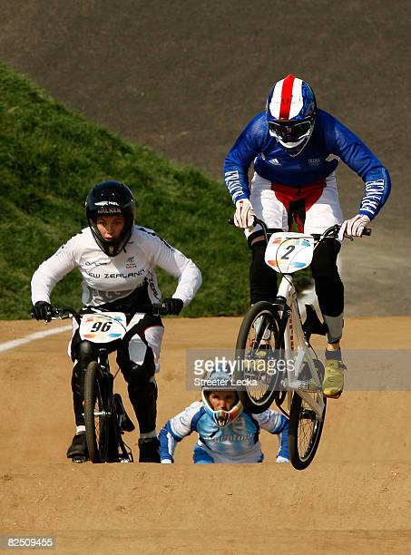 Sarah Walker of New Zealand, Gabriela Diaz of Argentina and Anne-Caroline Chausson of France race in the women's BMX semifinal held at the Laoshan...
