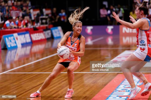 Sarah Wall of the Giants takes the ball during the round seven Super Netball match between the Swifts and the Giants at Sydney Olympic Park Sports...