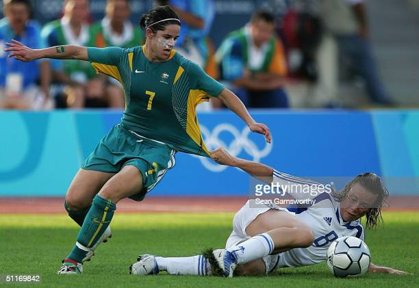Sarah Walsh for Australia and Konstantina Katsaiti for Greece in action during the women's football preliminary match between Australia and Greece on...