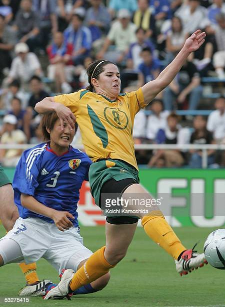Sarah Walsh of Australia and Aya Shimokozuru of Japan battle for the ball during a tour match between Australia and Japan on July 23 2005 in Tokyo...