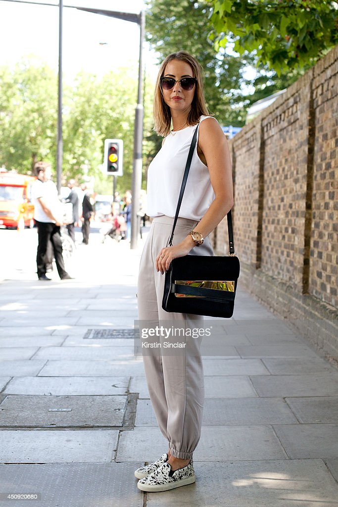 Sarah wears Whistles shoes and a Sophie Hulme bag on day 3 of London Collections: Men on June 17, 2014 in London, England.