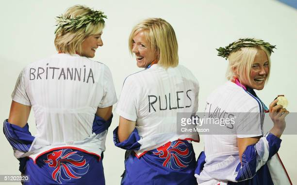 Sarah Webb Shirley Robertson and Sarah Ayton of Great Britain pose with their tshirts after winning gold in the women's keelboat yngling event on...