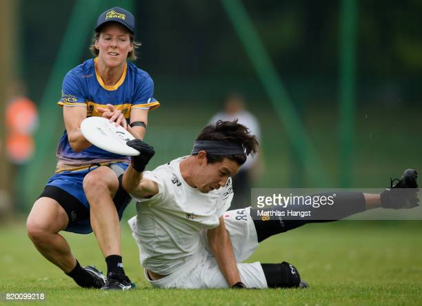 Sarah Wentworth of Australia and Andy Kunieda of Japan compete for the frisbee during the Ultimate Mixed Flying Disc Qualification match between...