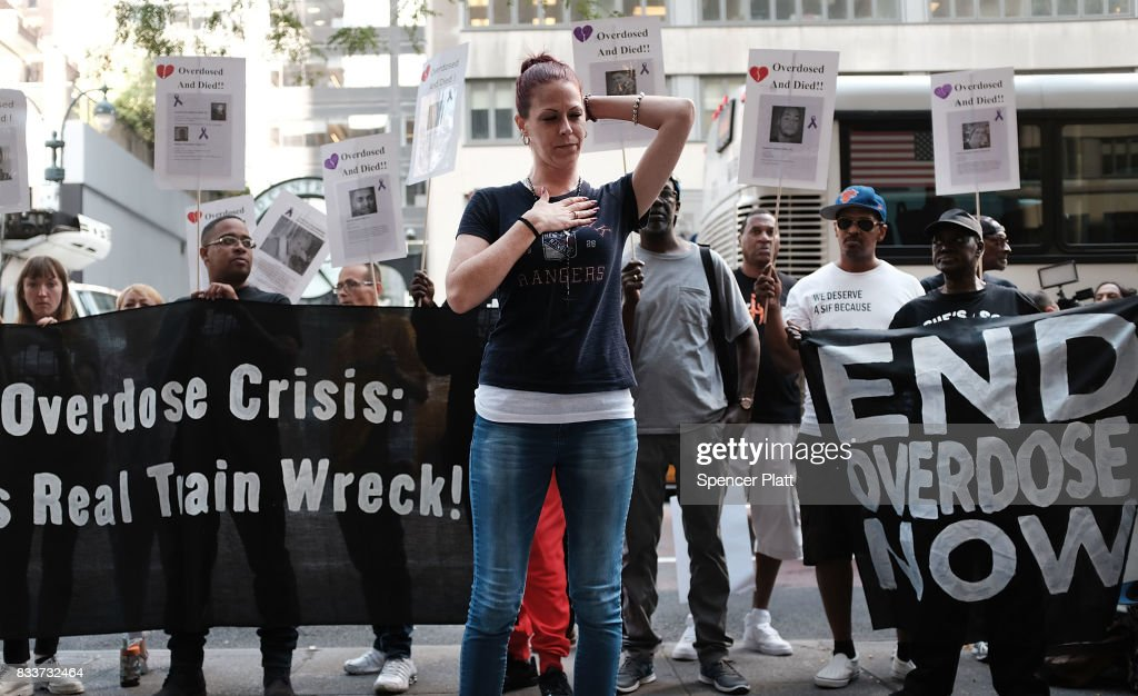 Sarah Wilson joins other recovering drug users, activists and social service providers as they hold a morning rally calling for 'bolder political action' in combating the overdose epidemic outside of the office of Governor Andrew Cuomo on August 17, 2017 in New York City. According to the latest data available from the National Institute on Drug Abuse, nearly 35,000 people across America died of heroin or opioid overdoses in 2015.