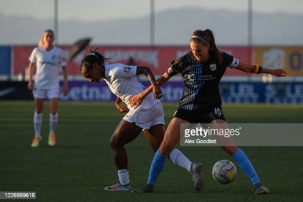 Sarah Woldmoe of Sky Blue FC fights for the ball against Crystal Dunn of North Carolina Courage during a game on day 8 of the NWSL Challenge Cup at...