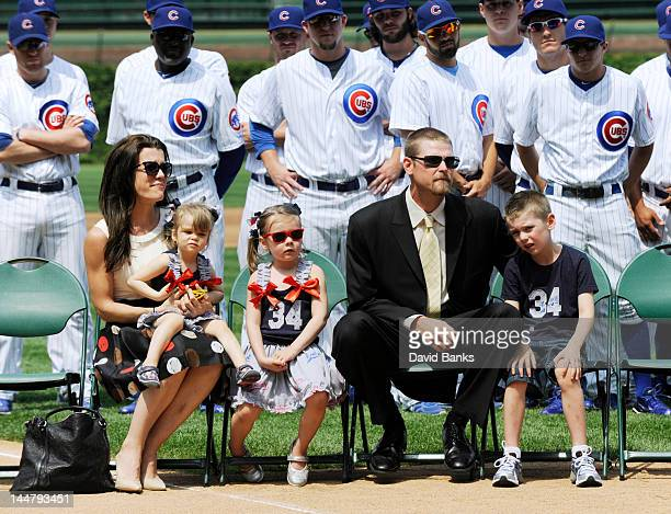 Sarah Wood Charlie Wood Katie Wood Kerry Wood and Justin Wood at Kerry Wood's formal retirement anouncement before a a game between the Chicago Cubs...